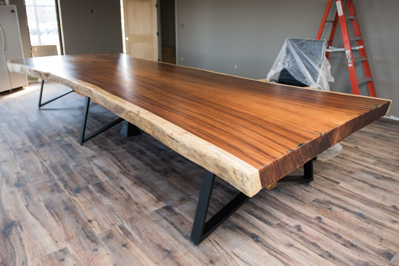 Conference table built by Walker Woodworking using on of our Guanacaste Live Edge Slabs.